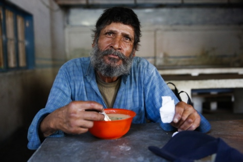 Luis Mendoza, 58, poses for a picture at the Mother Teresa of Calcutta eating center in Caracas