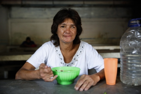 Marisol Gil, poses for a picture at the Mother Teresa of Calcutta eating center in Caracas