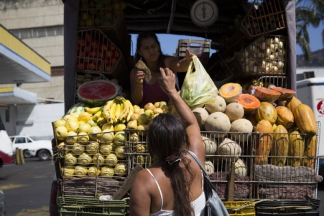 Fernanda Bolivar, 54, buys greens at a street vendor close to the Mother Teresa of Calcutta eating center in Caracas